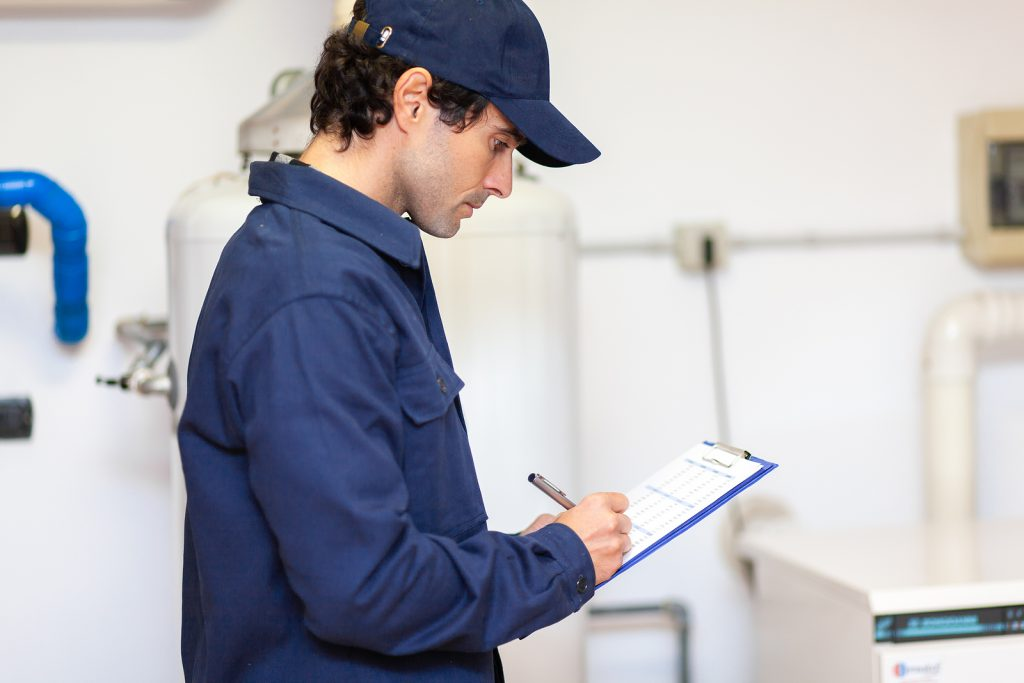 Hot water plumber in Canberra servicing installation